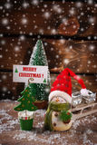 Christmas  decoration with snow on wooden background Royalty Free Stock Images