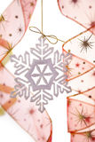 Christmas decoration with snowflake and ribbons Stock Images