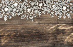 Christmas Decoration Snowflakes With Snowfall EffectChristmas De Over Rustic Wooden Background