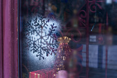 Christmas decoration snowflakes sputtering on glass Royalty Free Stock Photo
