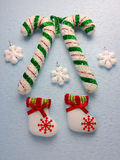 Christmas decoration: snowflakes and white felt boots. Stock Photo