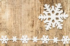 Christmas decoration. snowflakes on wood Royalty Free Stock Images