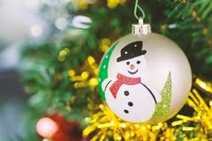 Snowman ball hanging on pine tree. Christmas decoration, snowman ball hanging on pine tree branch in Christmas day Royalty Free Stock Images