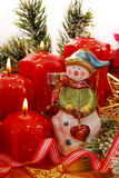 Christmas decoration with snowman and candles Royalty Free Stock Image
