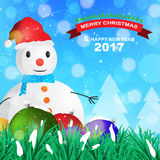 Christmas decoration with snowman and christmas ball on blue snowflake background. Rgb mode Royalty Free Stock Photo