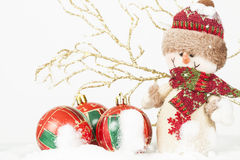 Christmas decoration with snowman figurine in the snow. Christmas decoration with closeup on snowman figurine in the snow Stock Images