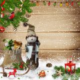 Christmas decoration with snowman and gift bag on a wooden background Stock Images