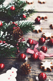 Christmas decoration with snowman, pine cones, xmas red balls and cookies Stock Images