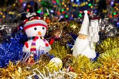 Christmas decoration, Snowman, Santa, balls, tinsel on blurred lights background Stock Photo