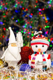 Christmas decoration, Snowman, Santa, balls, tinsel on blurred lights background Stock Photos