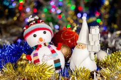 Christmas decoration, Snowman, Santa, balls, tinsel on blurred lights background Stock Images