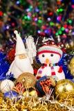 Christmas decoration, Snowman, Santa, balls, tinsel on blurred lights background Stock Images