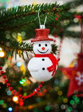 Christmas decoration snowman on the tree Stock Photography