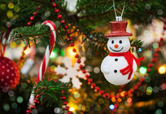 Christmas decoration snowman on the tree Royalty Free Stock Photo