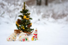 Christmas decoration. Some Christmas toys in the snow near a Christmas tree royalty free stock images