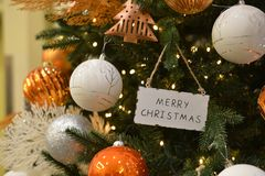 Christmas decoration with sparkling balls in orange stock image