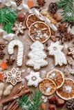 Christmas decoration with spices and cookies in the shape of snowflakes on dark brown paper background. Top view. stock photo