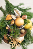 Christmas decoration with spruce and golden baubles Royalty Free Stock Photo