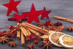 Christmas decoration with star anise, cinnamon with dry citruson on wood. Christmas decoration with star anise, cinnamon with dry citrus  on dark wood Stock Photo