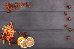 Christmas decoration with star anise, cinnamon stick in frame with free space for text.Top view on wood. Stock Images
