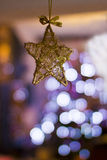 Christmas decoration star with Christmas tree lights Stock Images