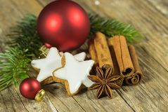 Christmas still life with star biscuit, spices and ornaments on wooden table. Christmas decoration with star cookies, spices and decoration on wood table stock image