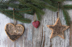 Christmas decoration, star and hearts, and conifer of fir tree o Royalty Free Stock Photo