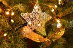 Christmas decoration, star and lights Stock Photos