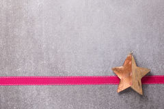 Christmas  decoration  star  and ribbon on  grey slate  backgrou Royalty Free Stock Photo