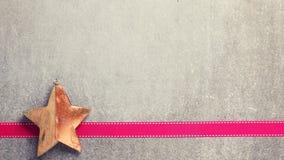 Christmas  decoration  star  and ribbon on  grey slate  backgrou Royalty Free Stock Photos