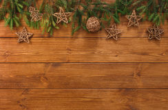 Christmas decoration, stars and garland frame background. Christmas decoration, stars and garland frame concept background, top view with copy space on wood Royalty Free Stock Photos