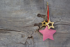 Christmas decoration stars hanging on wooden background Stock Photography
