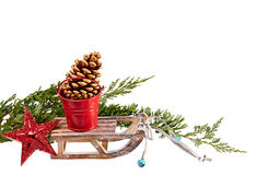 Christmas Decoration ( stars,wood sled,metal bucket) isolated on Royalty Free Stock Photos
