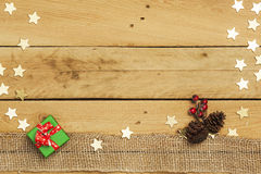 Christmas, decoration and stars on wooden background Stock Image