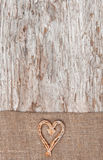 Christmas decoration with straw heart and burlap Royalty Free Stock Images