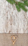 Christmas decoration with straw heart and burlap Stock Image