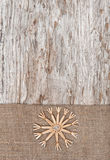 Christmas decoration with straw snowflake and burlap Royalty Free Stock Photos