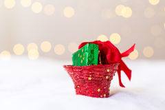 Christmas decoration in studio with bokeh. Xmas decoration on white and christmas lights unfocused in the background Stock Image