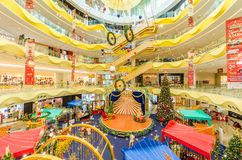 Christmas decoration in Sunway Velocity Mall. People can seen exploring and shopping around it. Stock Photo