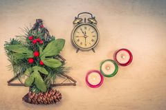 Christmas decoration on table with burning candle stock photos