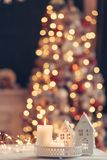 Christmas decoration on a table over blurred lights stock photo