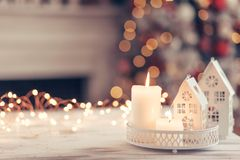 Christmas decoration on a table over blurred lights royalty free stock images