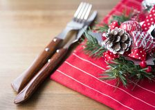 Christmas Decoration Table Set on Wooden Background Natural Light Selective Focus. Holiday Christmas Decorative Composition with Pine Cone Fir Tree Branches Stock Images