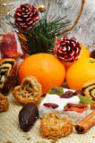 Christmas decoration with tangerines, turkish delight; lokum. Royalty Free Stock Photography