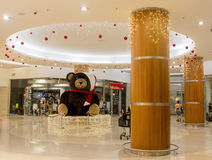 Christmas decoration Teddy Bear in shopping mall. Christmas eve. Stock Photography
