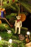 Christmas decoration. Teddy bear. Slice orange on tree. Xmas decorated tree. Royalty Free Stock Image
