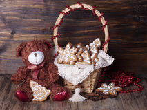Christmas decoration with teddy bears in a basket and cookies. Royalty Free Stock Photo