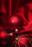Christmas decoration theme. Christmas decoration on a red silky background Stock Image