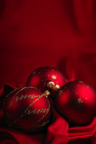 Christmas decoration theme. Christmas decoration on a red silky background Stock Images