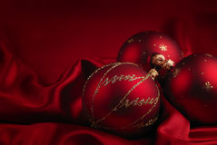 Christmas decoration theme. Christmas decoration on a red silky background Stock Photo